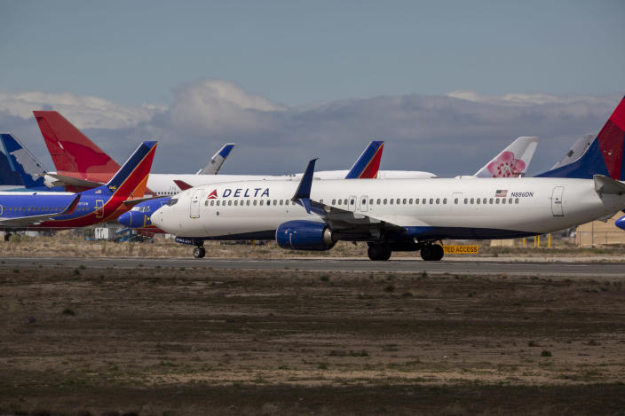 VICTORVILLE, CA - MARCH 24: A Delta Air Lines jet taxis to be parked with a growing number of jets at Southern California Logistics Airport (SCLA) on March 24, 2020 in Victorville, California. As the coronavirus pandemic grows, exponentially increasing travel restrictions and the numbers of people in quarantine, airlines around the world are scrambling to find places to park a majority of their fleet as they wait to see how the situation will play out. (Photo by David McNew/Getty Images)