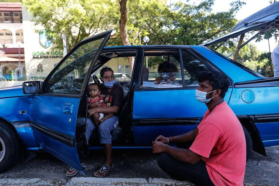 S. Ganesh, his wife Parameswari, and three young children have had to live out of his car after their house on Carnarvon Street caught fire in April. — Picture by Sayuti Zainudin