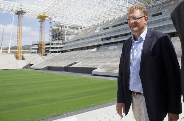 FIFA Secretary General Jerome Valcke visits the Arena Corinthians construction site, in Sao Paulo, Brazil, Monday, Aug. 19, 2013. The new stadium will host the opening match of the World Cup in 2014. (AP Photo/Andre Penner)