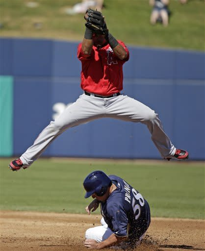 Los Angeles Angels' Erick Aybar, top, leaps over Milwaukee Brewers' Josh Prince (58) as Prince steals second during the second inning of an exhibition spring training baseball game on Saturday, March 2, 2013, in Phoenix. (AP Photo/Morry Gash)