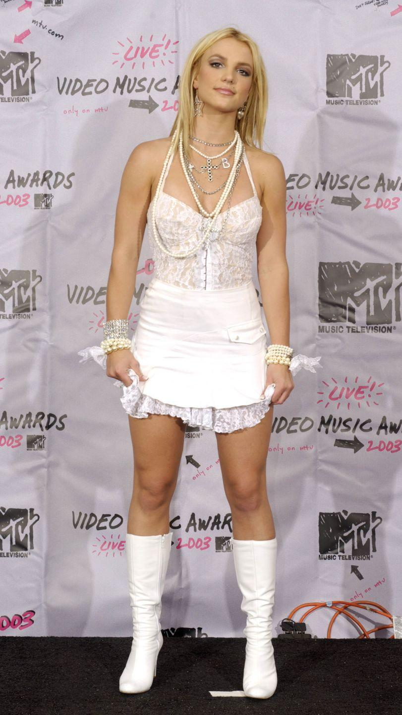 <p>Britney Spears performed with Madonna that night, so it was only fitting that she wore this white bridal look in 2003, which paid homage to Madonna's 1984 outfit (see slide 1).</p>