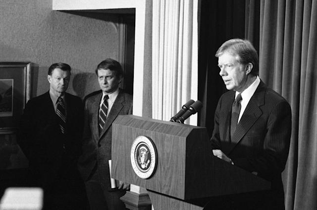 <p>President Jimmy Carter faces reporters in the White House press room, Dec. 28, 1979. National Security Advisor Zbigniew Brzezinski, left, and White House Press Secretary Jody Powell look on. Carter commented on the situations in Afghanistan and Iran. (Photo: AP) </p>