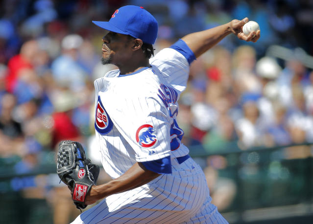 Chicago Cubs pitcher Edwin Jackson throws against the Cincinnati Reds during the first inning of a spring training baseball game, Saturday, March 22, 2014, in Mesa, Ariz. (AP Photo/Matt York)