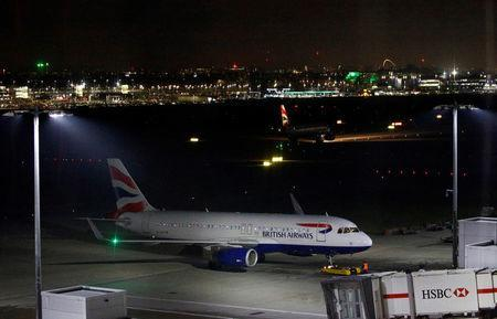 A British Airways aircraft sits on the tarmac at Heathrow Airport in London, Britain January 8, 2019. REUTERS/Henry Nicholls
