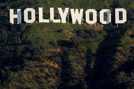 FILE PHOTO: The iconic Hollywood sign is shown on a hillside above a neighborhood in Los Angeles