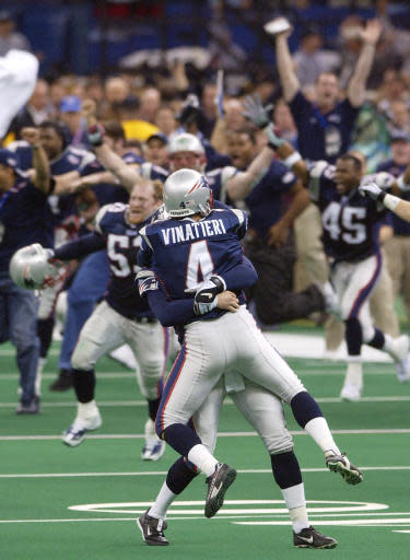 "FILE - In this Feb. 3, 2002, file photo, New England Patriots' Adam Vinatieri (4) is lifted into the air as his teammates charge the field after his game-winning 48-yard field goal beat the St. Louis Rams 20-17 in NFL football Super Bowl 36 in New Orleans. A pair of Super Bowl winning teams that launched dynasties in San Francisco and New England highlighted the list of the NFL's greatest teams, numbers 31-100. The Patriots won a surprise title in 2001 after the untested Tom Brady took over from the injured Drew Bledsoe early in the season. New England needed a favorable ruling and dramatic kick by Adam Vinatieri to win the ""Tuck Rule"" game against Oakland, won at Pittsburgh in the AFC championship game and slowed down the dynamic Rams offense for the franchise's first title. That team ranked 51st. (AP Photo/Kathy Willens, File)"