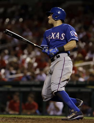 Texas Rangers' Ian Kinsler hits an RBI-single during the seventh inning of a baseball game against the St. Louis Cardinals on Monday, June 24, 2013, in St. Louis. (AP Photo/Jeff Roberson)