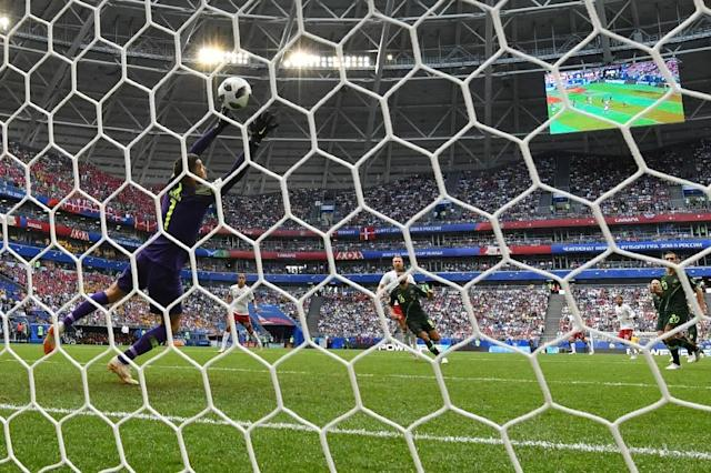 Christian Eriksen scores past Australia goalkeeper Mathew Ryan (AFP Photo/Fabrice COFFRINI)