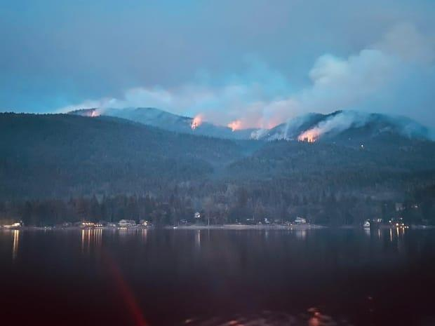 The Canim Lake fire is about 1,200 hectares in size and is out of control. Leanne Sallenback said she and other community members take boats onto the lake to monitoring the fire themselves. (Leanne Sallenback/Submitted - image credit)