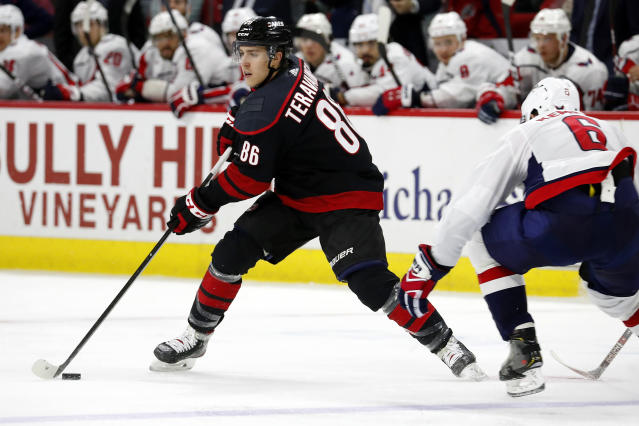 Carolina Hurricanes' Teuvo Teravainen (86), of Finland, moves the puck next to Washington Capitals' Michal Kempny (6), of the Czech Republic, during the second period of an NHL hockey game in Raleigh, N.C., Friday, Jan. 3, 2020. (AP Photo/Karl B DeBlaker)