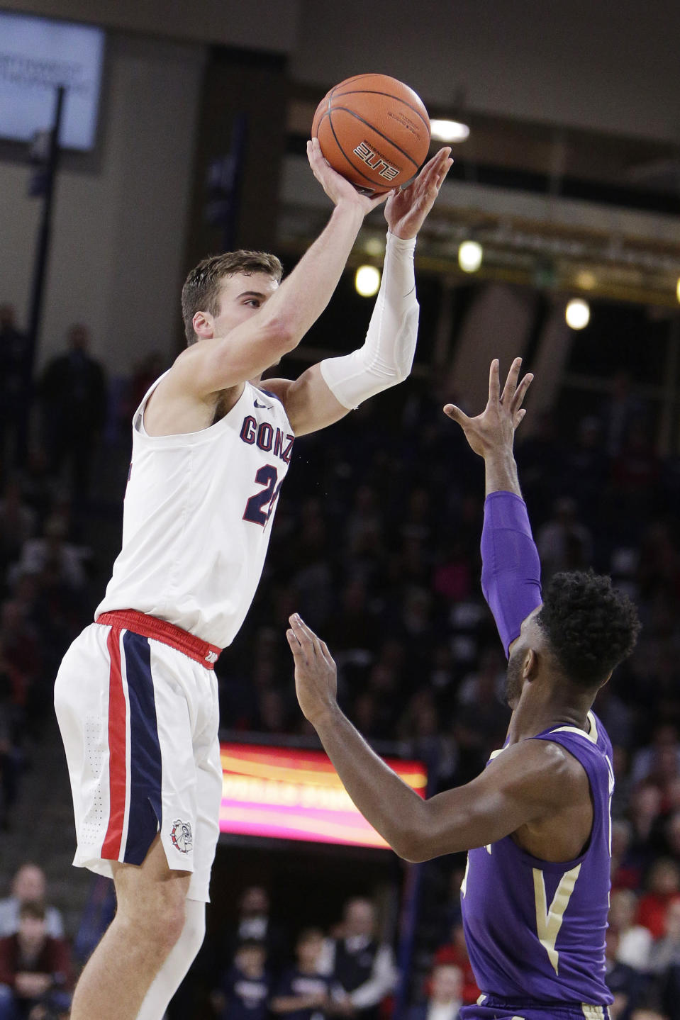 Gonzaga forward Corey Kispert, left, shoots while defended by Washington guard Jaylen Nowell during the first half of an NCAA college basketball game in Spokane, Wash., Wednesday, Dec. 5, 2018. (AP Photo/Young Kwak)