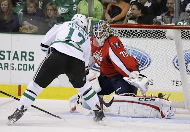Dallas Stars' Rich Peverley, left, has his shot blocked by Washington Capitals goalie Braden Holtby (70) in the first period of an NHL hockey game on Saturday, Oct. 5, 2013, in Dallas. (AP Photo/Tony Gutierrez)