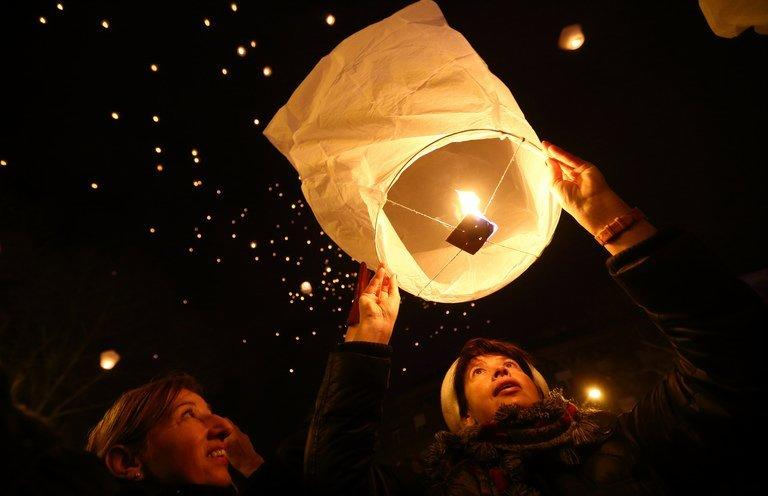 Croatians release lanterns into the night sky with Christmas and New Year's wishes, in Zagreb on December 20, 2012