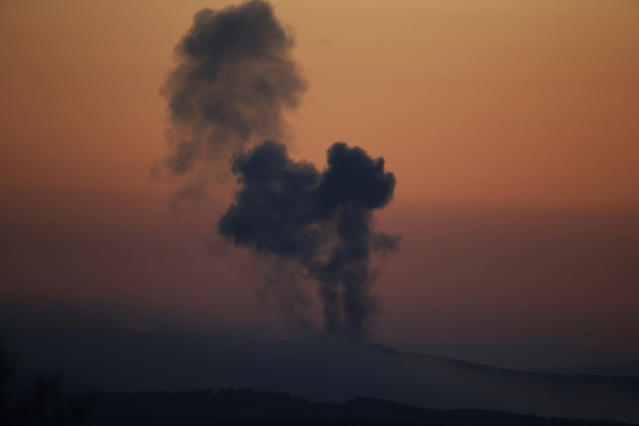 <p>Plumes of smoke rise on the air from inside Syria, as seen from the outskirts of the border town of Kilis, Turkey on Jan. 20, 2018. (Photo: Lefteris Pitarakis/AP) </p>