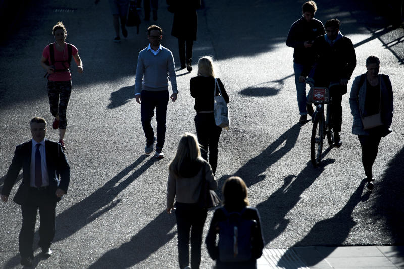 Commuters silhouetted in early morning sunlight as they walk along the southern bank of the River Thames in central London as Storm Aileen brought howling gusts and heavy showers to parts of the UK.
