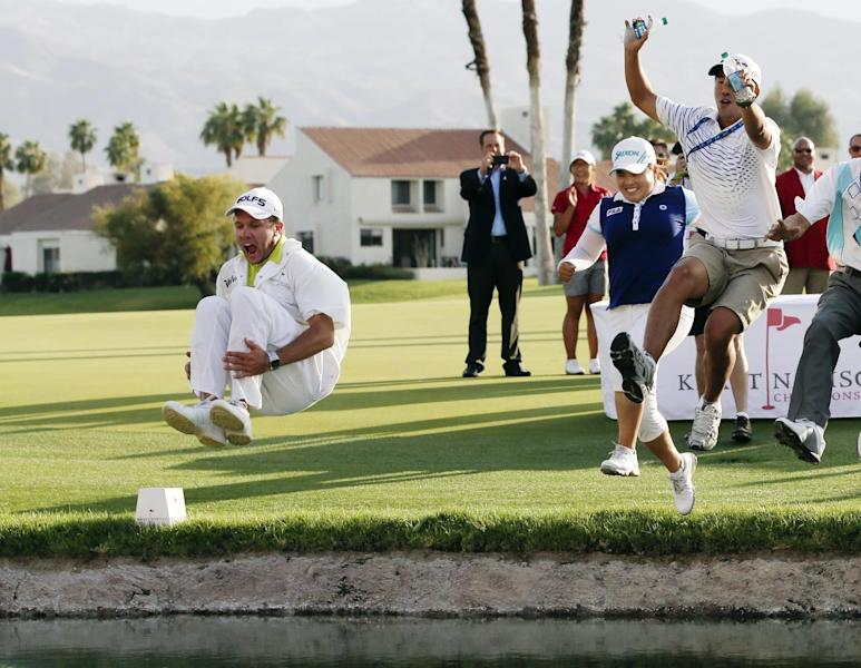 Inbee Park, second from right, of South Korea, celebrates by jumping into Poppy's Pond with caddie Brad Beecher, left, after winning the LPGA Kraft Nabisco Championship golf tournament in Rancho Mirage, Calif., Sunday, April 7, 2013. (AP Photo/Chris Carlson)