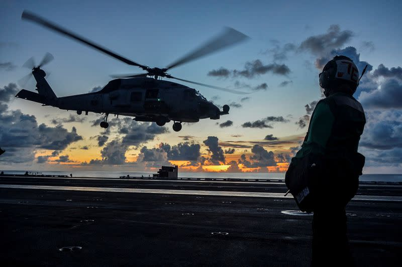 FILE PHOTO: Sea Hawk helicopter launches during flight operations aboard the U.S. Navy aircraft carrier USS Ronald Reagan in the South China Sea