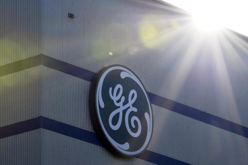 Troubled US industrial conglomerate General Electric says it is making progress in its restructuring plan despite massive charges in the fourth quarter and an SEC probe into accounting practices in its insurance business