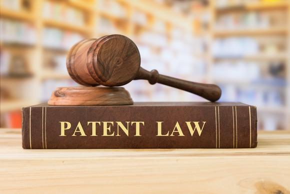 A gavel sitting on top of a book titled Patent Law.
