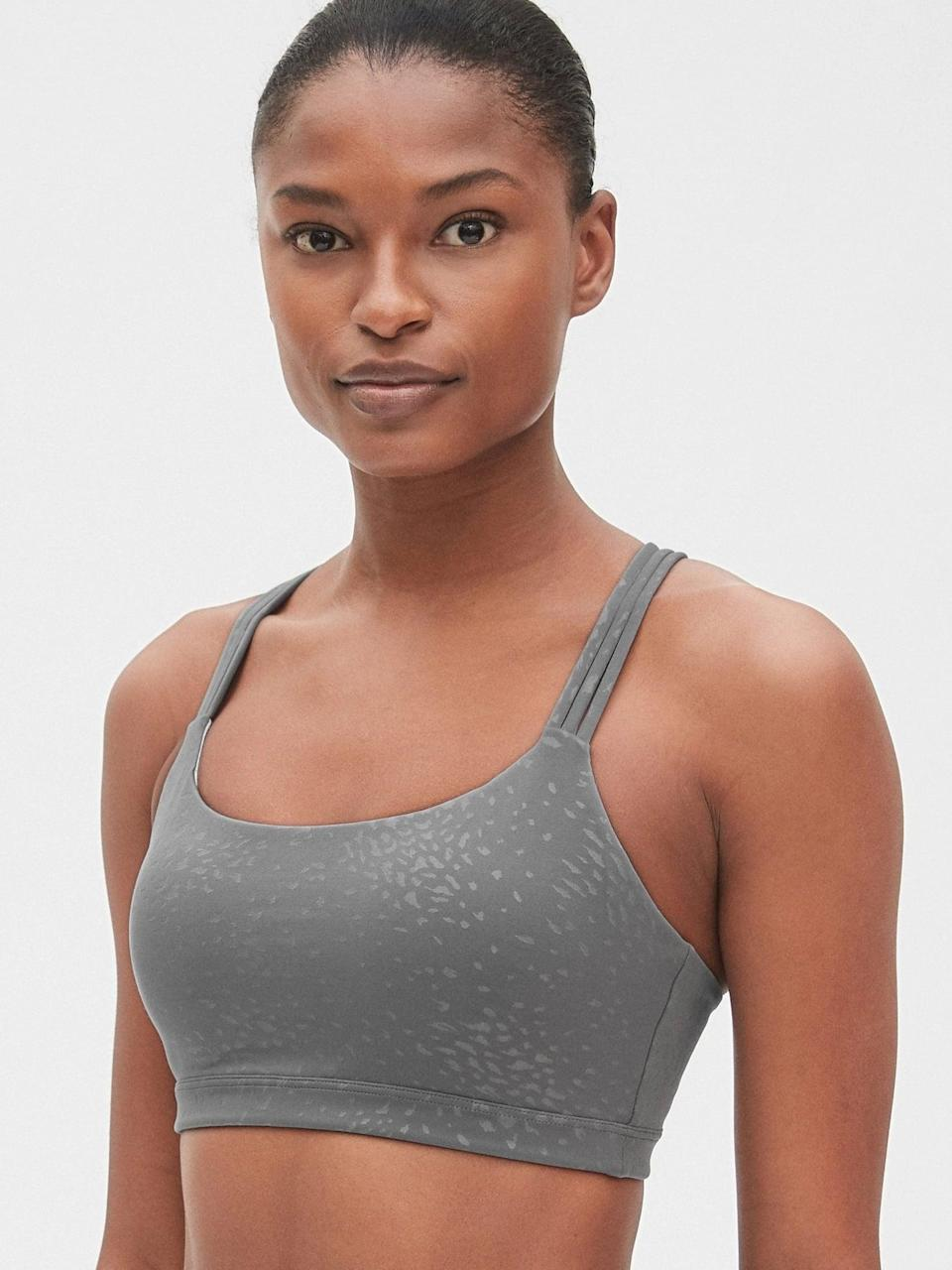 <p>This <span>GapFit Eclipse Medium-Support Strappy Sports Bra</span> ($30, originally $40) takes away the struggle we're all too familiar with of actually getting your sports bra on. It's comfortable and great for low-impact workouts.</p>