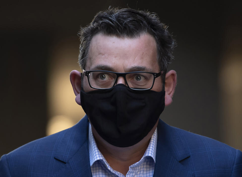 Victorian Premier Daniel Andrews arrives at a press conference during lockdown due to the continuing spread in Melbourne, Thursday, Aug. 6, 2020. Victoria state, Australia's coronavirus hot spot, announced on Monday that businesses will be closed and scaled down in a bid to curb the spread of the virus. (AP Photo/Andy Brownbill)