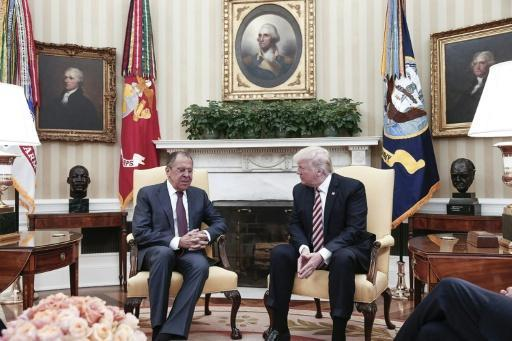 White House fumes after Moscow releases Trump meeting photos
