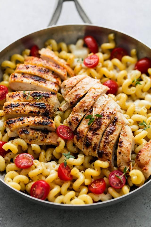 "<p>Two power couples here: chicken and pasta + tomato and mozz.</p><p>Get the recipe from <a href=""https://www.delish.com/cooking/recipe-ideas/recipes/a52046/caprese-chicken-pasta-recipe/"" target=""_blank"">Delish</a>.</p>"