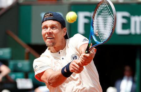 FILE PHOTO - Tennis - French Open - Roland Garros, Paris, France - May 30, 2018 Czech Republic's Tomas Berdych in action during his first round match against France's Jeremy Chardy REUTERS/Pascal Rossignol
