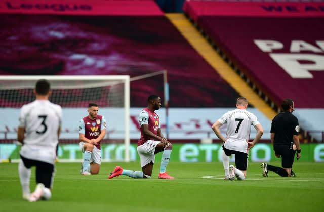 Players and officials took a knee in support of the Black Lives Matter movement after the whistle was blown for kick-off (Shaun Botterill/NMC Pool/PA)