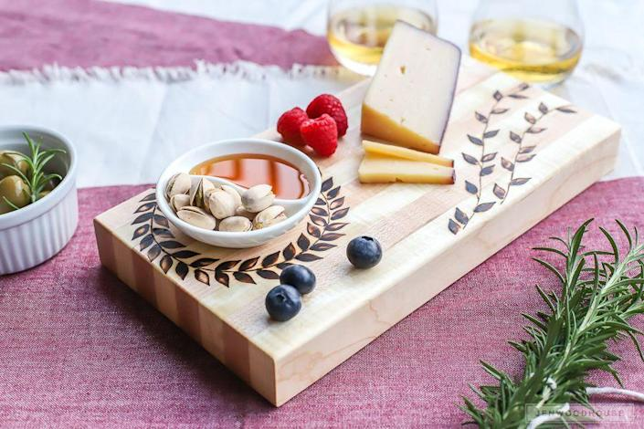 """<p>Is your mom constantly entertaining, hosting, and cooking? This wood-burning craft yields an intricate, rustic-looking cutting board she can use to serve guests with even more style.</p><p><strong>Get the tutorial at <a href=""""https://jenwoodhouse.com/wood-burned-cutting-board/"""" rel=""""nofollow noopener"""" target=""""_blank"""" data-ylk=""""slk:The House of Wood."""" class=""""link rapid-noclick-resp"""">The House of Wood.</a></strong></p><p><a class=""""link rapid-noclick-resp"""" href=""""https://go.redirectingat.com?id=74968X1596630&url=https%3A%2F%2Fwww.walmart.com%2Fip%2FCraft-and-Hobby-Wood-Burning-Art-Tool-Kit-Accessories%2F852829099&sref=https%3A%2F%2Fwww.thepioneerwoman.com%2Fholidays-celebrations%2Fgifts%2Fg32307619%2Fdiy-gifts-for-mom%2F"""" rel=""""nofollow noopener"""" target=""""_blank"""" data-ylk=""""slk:SHOP WOOD CRAFTING TOOLS"""">SHOP WOOD CRAFTING TOOLS</a></p>"""