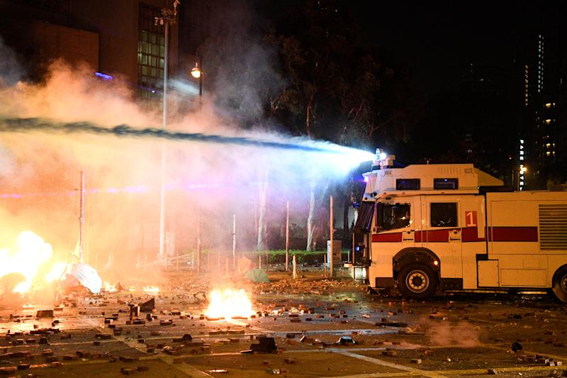 The police use a water cannon during clashes with anti-government protesters at Hong Kong Polytechnic University in Hong Kong, China November 17, 2019. REUTERS/Laurel Chor