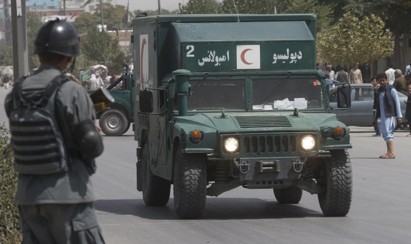 An Afghan military ambulance rushes towards the site of an explosion near police headquarters in Kabul, Afghanistan, Wednesday, Aug. 7, 2019. A suicide car bomber targeted the police headquarters in a minority Shiite neighborhood in western Kabul on Wednesday, setting off a huge explosion that wounded dozens of people, Afghan officials said. The Taliban claimed responsibility for the attack. (AP Photo/Rafiq Maqbool)