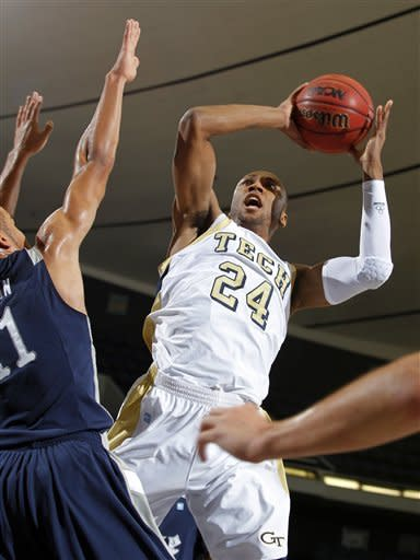 Georgia Tech forward Kammeon Holsey (24) shoots over Rice forward Ross Wilson, left, defending during the first half of their NCAA college basketball game in the first round of the DirecTV Classic in Anaheim, Calif., Thursday, Nov. 22, 2012. (AP Photo/Alex Gallardo)
