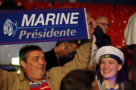 Supporters wait for the start of a campaign political rally for Marine Le Pen, French National Front (FN) political party leader and candidate for French 2017 presidential election, in Paris, France, April 17, 2017. REUTERS/Pascal Rossignol