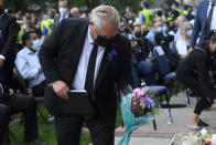 <p>Ontario Premier Doug Ford places flowers at a vigil for the victims of the deadly vehicle attack on five members of the Canadian Muslim community in London, Ont., on Tuesday, June 8, 2021. Four of the members of the family died and one is in critical condition. Police have charged a London man with four counts of murder and one count of attempted murder. THE CANADIAN PRESS/Nathan Denette</p>