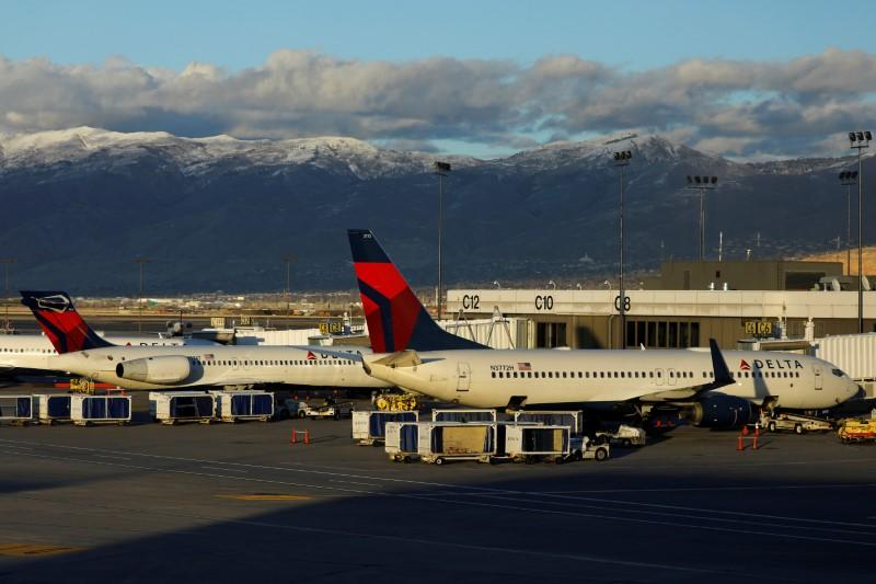 FILE PHOTO: Delta Air Lines planes are shown parked at their gates at the airport in Salt Lake City