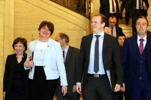 Northern Ireland's Democratic Unionist Party (DUP) leader Arlene Foster (second left), with party colleagues, make their way into a session of the Northern Ireland Assembly after reaching agreement with Republican Sinn Fein on reforming the Stormont executive