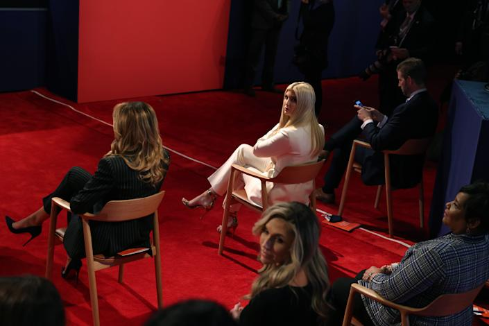 First lady Melania Trump, left, Ivanka Trump, center, and Eric Trump, right, sit next to each other at the first presidential debate at the Health Education Campus of Case Western Reserve University on September 29, 2020 in Cleveland, Ohio.