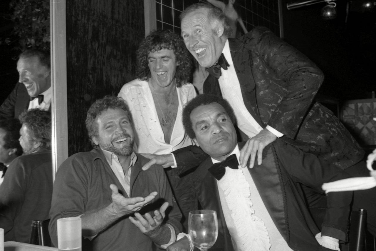 <p>Stringfellow (top left) at a fashion show at his London club with Lee Major, Kenny Lynch and Bruce Forsyth in 1982. (Rex) </p>