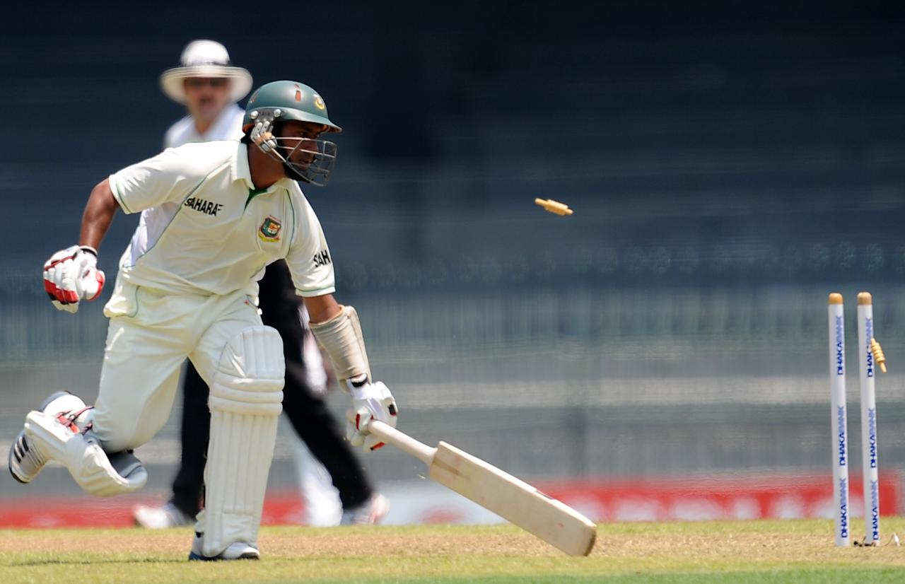 Bangladeshi cricketer Mohammad Ashraful runs to the crease as he is run out during the opening day of their second Test cricket match between Sri Lanka and Bangladesh at the R. Premadasa Cricket Stadium in Colombo on March 16, 2013.  AFP PHOTO/ LAKRUWAN WANNIARACHCHI