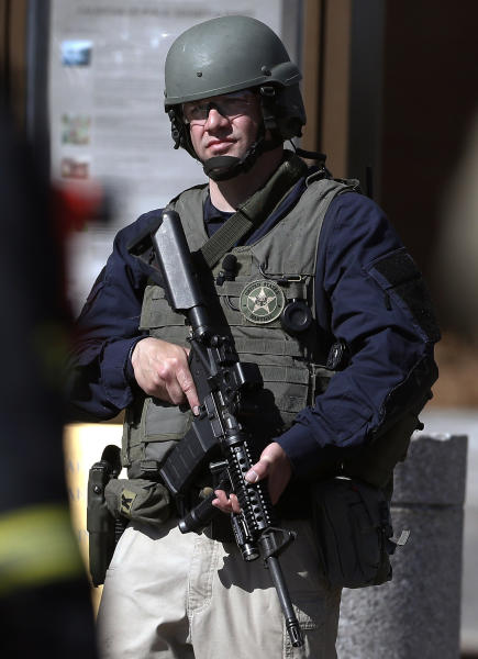 A heavily armed United States Marshall stands guard outside the Moakley Federal Court House in Boston after the building was evacuated, Wednesday, April 17, 2013. The U.S. Marshals Service in Washington says the courthouse was evacuated due to a bomb threat. Spokeswoman Nikki Credic-Barrett says authorities are conducting a security sweep. (AP Photo/Michael Dwyer)