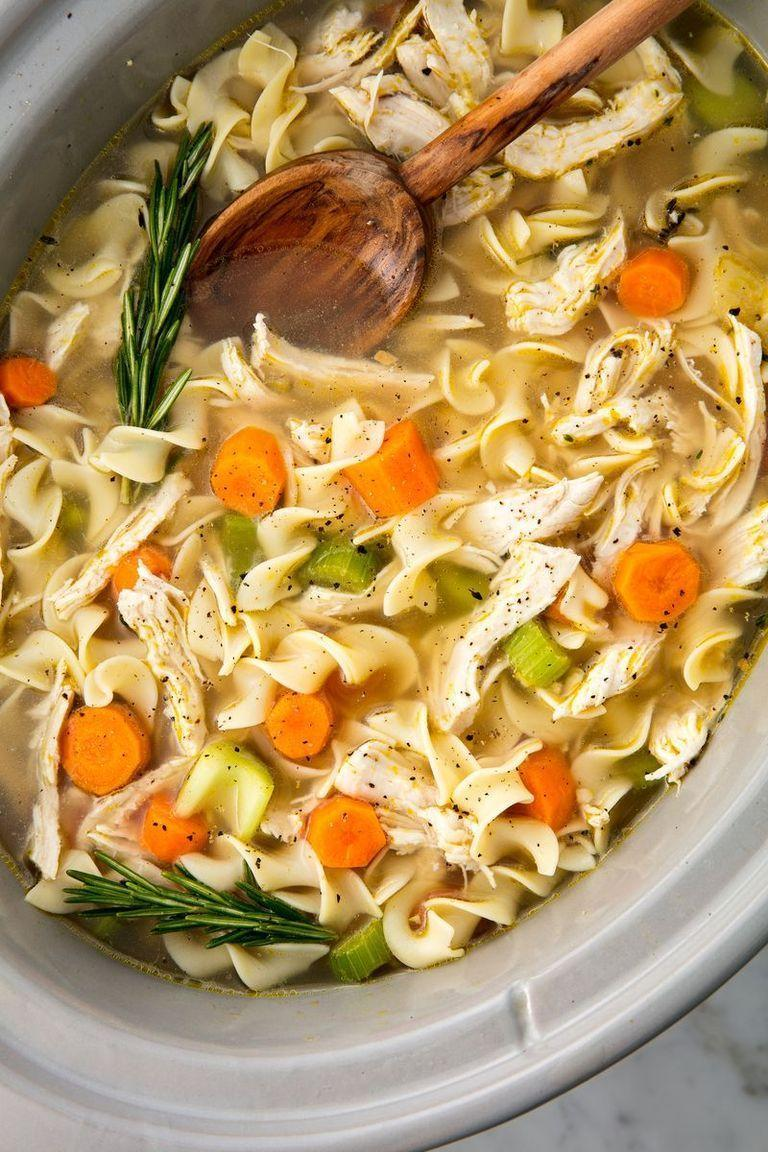 """<p>Homemade chicken noodle soup is already easy to whip up, but tossing all of your ingredients in a slow cooker makes it even easier. </p><p>Get the <a href=""""https://www.delish.com/uk/cooking/recipes/a29124077/easy-crockpot-chicken-noodle-soup-recipe/"""" rel=""""nofollow noopener"""" target=""""_blank"""" data-ylk=""""slk:Slow Cooker Chicken Noodle Soup"""" class=""""link rapid-noclick-resp"""">Slow Cooker Chicken Noodle Soup</a> recipe.</p>"""