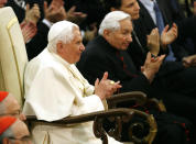 FILE - In this Saturday, Oct. 27, 2007 file photo Pope Benedict XVI and his brother Georg, right, attend a concert by the Symphonic Orchestra Bayerischer Rundfunk and the Bamberger Symphoniker at the Paul VI Hall at the Vatican. The Rev. Georg Ratzinger, the older brother of Emeritus Pope Benedict XVI, who earned renown in his own right as a director of an acclaimed German boys' choir, has died at age 96. The Regensburg diocese in Bavaria, where Ratzinger lived, said in a statement on his website that he died on Wednesday, July 1, 2020. (AP Photo/Andrew Medichini, File)