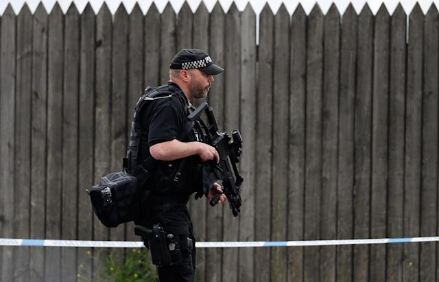 <p>Armed police officers patrol a police cordon near the Manchester Arena in Manchester, Wednesday, May 24, 2017. Britons will find armed troops at vital locations Wednesday after the official threat level was raised to its highest point following a suicide bombing that killed more than 20, as new details emerged about the bomber. (AP Photo/Kirsty Wigglesworth) </p>