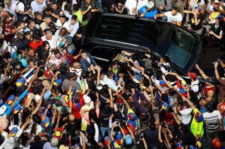 Venezuelan opposition leader and self-proclaimed interim president Juan Guaido is greeted by supporters as he leaves a rally against Venezuelan President Nicolas Maduro's government in Caracas, Venezuela February 2, 2019. REUTERS/Adriana Loureiro