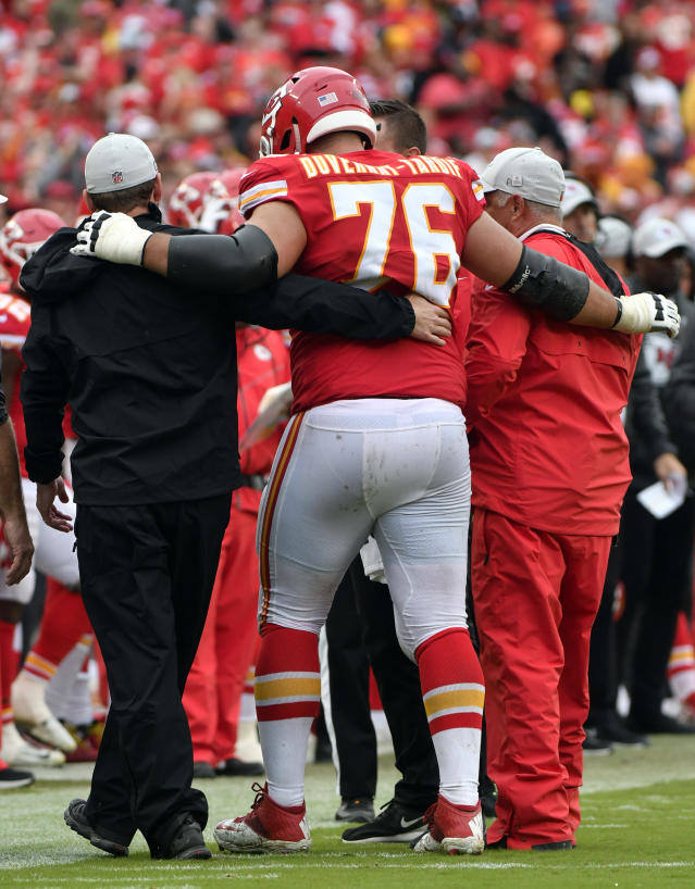 FILE - In this Sunday, Oct. 7, 2018 file photo,Kansas City Chiefs offensive lineman Laurent Duvernay-Tardif (76) is helped off the field during the second half of an NFL football game against the Jacksonville Jaguars in Kansas City, Mo. The Chiefs placed right guard Laurent Duvernay-Tardif and safety Armani Watts on injured reserve Tuesday, Oct. 9, 2018 and signed outside linebacker Frank Zombo to provide depth at that depleted position.(AP Photo/Ed Zurga, File)