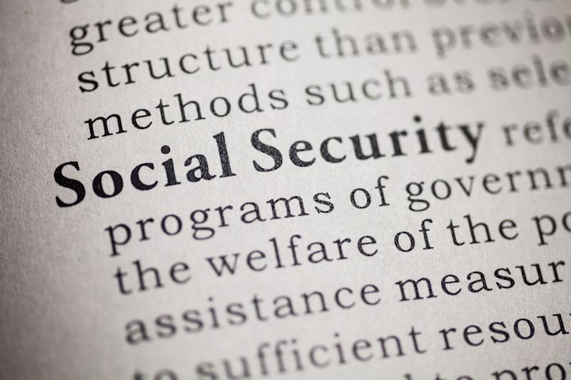"""Closeup of a dictionary page, defining the words """"Social Security"""""""