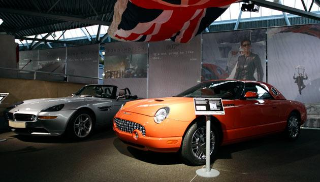 "A picture shows the BMW Z8 (L) from the 1999 James Bond film ""The World is Not Enough"" sitting next to the Ford Thurderbird (R) used in the 2002 Bond film ""Die Another Day"" on display at the opening of a press preview of the Bond in Motion exhibition at the Beaulieu National Motor Museum at Brockenhurst in the southern English county of Hampshire on January 15, 2012. The Bond in Motion exhbition features fifty original iconic vehicles used in the James Bond films to celebrate fifty years of 007 and will open to the public from January 17. AFP PHOTO/ JUSTIN TALLIS"