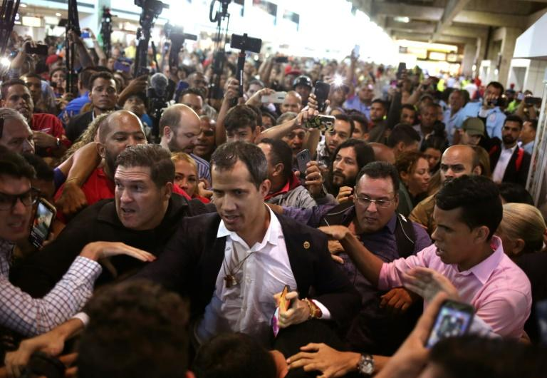 Juan Guaido received a mixed reception at the Caracas international airport on February 11 with some Maduro supporters calling him a 'fascist' and 'traitor'