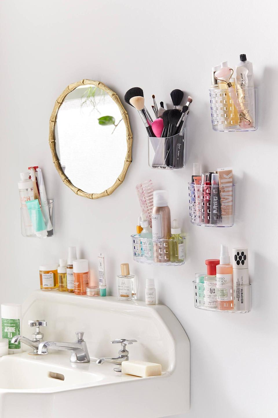 "<p>These <a href=""https://www.popsugar.com/buy/Acrylic-Toiletries-Wall-Pockets-551631?p_name=Acrylic%20Toiletries%20Wall%20Pockets&retailer=urbanoutfitters.com&pid=551631&price=8&evar1=casa%3Aus&evar9=47251564&evar98=https%3A%2F%2Fwww.popsugar.com%2Fhome%2Fphoto-gallery%2F47251564%2Fimage%2F47252509%2FAcrylic-Toiletries-Wall-Pocket&list1=cleaning%2Corganization%2Cspring%20cleaning%2Csmall%20space%20living%2Cbathrooms%2Chome%20organization&prop13=mobile&pdata=1"" class=""link rapid-noclick-resp"" rel=""nofollow noopener"" target=""_blank"" data-ylk=""slk:Acrylic Toiletries Wall Pockets"">Acrylic Toiletries Wall Pockets</a> ($8) are great for makeup brushes and products.</p>"
